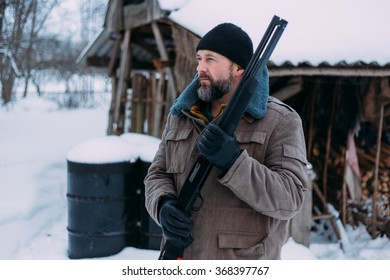 man with shotgun