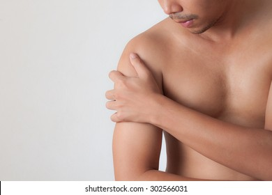 man with shoulder pain isolated on white background