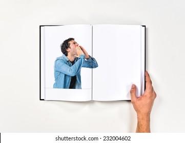 Man shouting printed on book