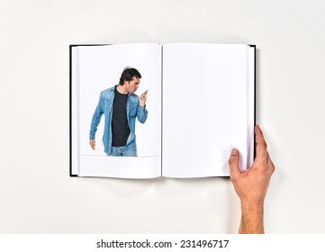 Man shoutting by mobile printed on book