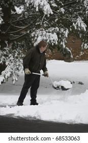 A man shovels snow