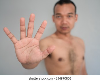 Man show hand for stop sign