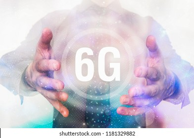 Man is showing 6G network interface symbol between his hands