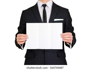 Man showing blank black flyer brochure booklet. Leaflet presentation. Pamphlet hold hands. Man show clear offset paper. Sheet template. Man in a black suit, white shirt and tie. On white background