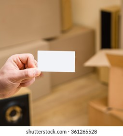Man showing blank credit card in new home