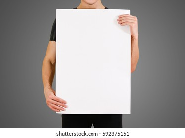 Man showing blank white big A2 paper. Leaflet presentation. Pamphlet hold hands. Man show clear offset paper. Sheet template. Booklet design sheet display read first person.