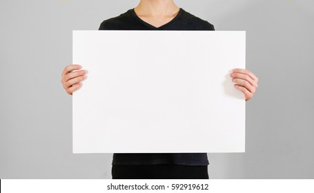 Man showing blank white big A2 paper. Leaflet presentation. Pamphlet hold hands. Man show clear offset paper. Sheet template. Booklet design sheet display read first person