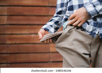 man showing the empty pockets, poor jobless homeless and moneyless concept