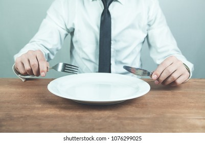 Man showing fork with knife. Time to eat