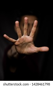 man showing hands and palm lines forward with blurred body - young man demonstrating strength of hands - concept of stop, strength, hands and dna - five fingers in the hand