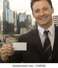 A man is showing his business card.