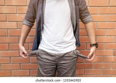 A man showing his empty pockets, No money