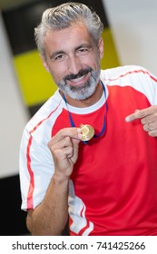 man showing his medal
