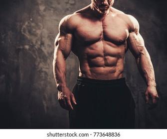Man showing his muscular body.