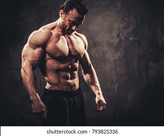 Man showing his muscular body.