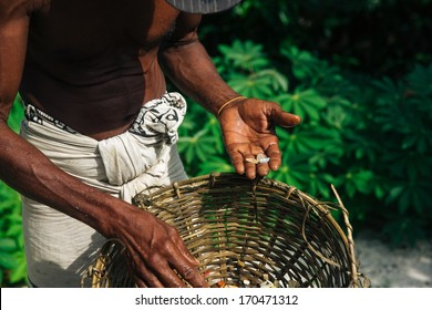 Man is showing moonstone - Moonstone mine in Sri Lanka