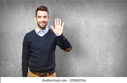 man showing number five
