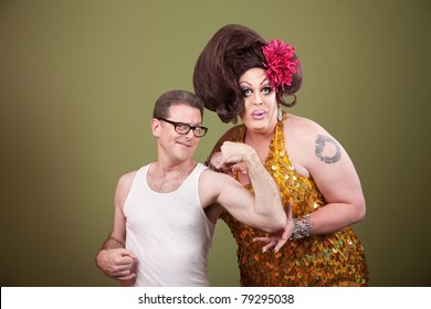 Man showing off bicep with large lady over green background