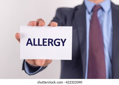 Man showing paper with ALLERGY text
