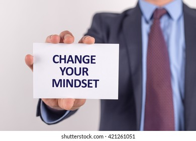 Man showing paper with CHANGE YOUR MINDSET text