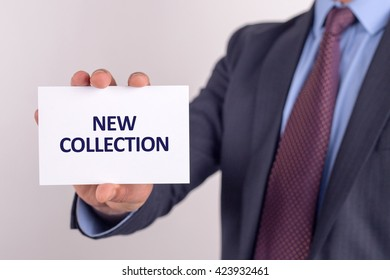 Man showing paper with NEW COLLECTION text