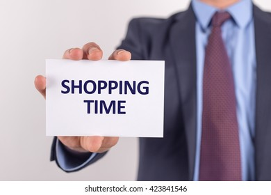 Man showing paper with SHOPPING TIME text