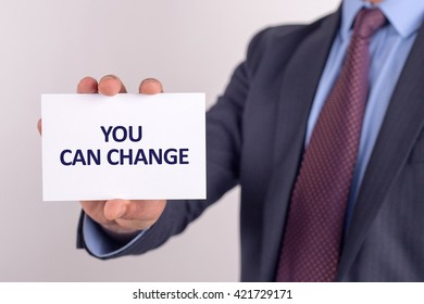 Man showing paper with YOU CAN CHANGE text