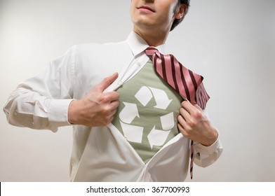 Man showing the symbol of recycling