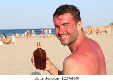 Man showing tanning lotion while getting sunburned