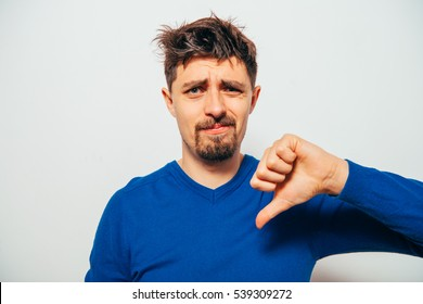 man showing a thumb down gesture