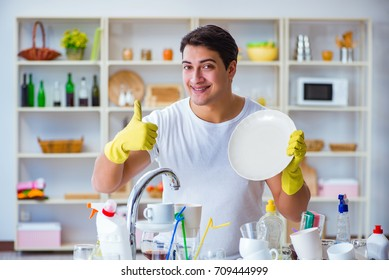 Man showing thumbs up washing dishes