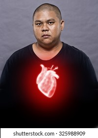 A man Showing X-ray heart.Heart attack concept.