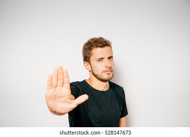 A man shows the hands stop timeout.