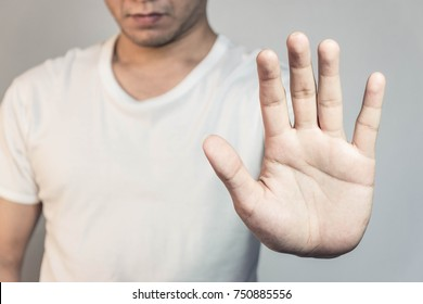 A man shows the hands stop timeout