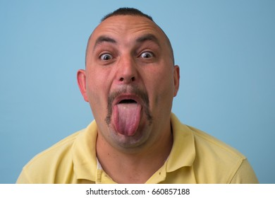 man shows his finger on the tongue