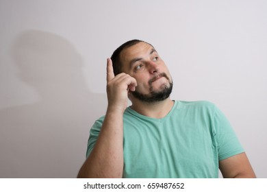 man shows his index finger up