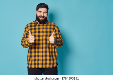 man shows his thumb and laughs at the camera a free space