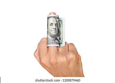 Man shows middle finger with dollar bill on it. Concept of bribe, dishonesty, hypocrisy. isolated on white background. show the middle finger. To give or take bribe, bribe taker, official, dishonest