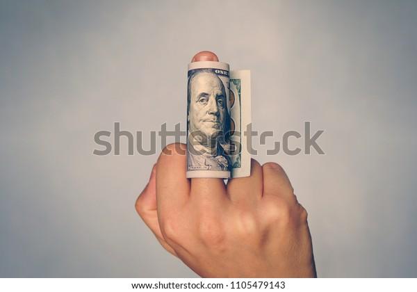 man-shows-middle-finger-dollar-600w-1105479143.jpg