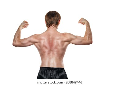 Man shows the muscles of the back. Isolated on white background. The concept of a strong man and a healthy lifestyle.