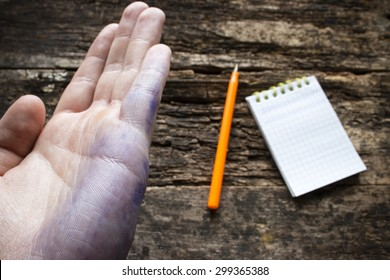 man shows the problem lefties dirty hand after writing close-up international lefthanders day