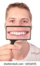 man shows  smile through  magnifier