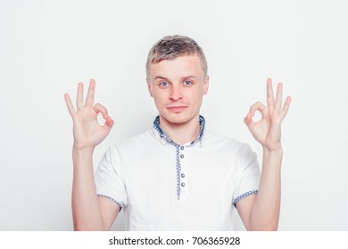 man shows that everything is fine, don't worry. all okay. Gesture. Close portrait.