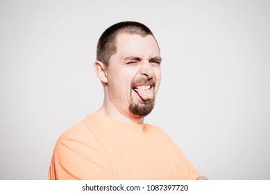 Man shows tongue