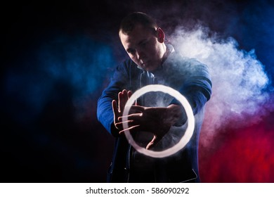 Man shows tricks with smoke. E-cigarettes.