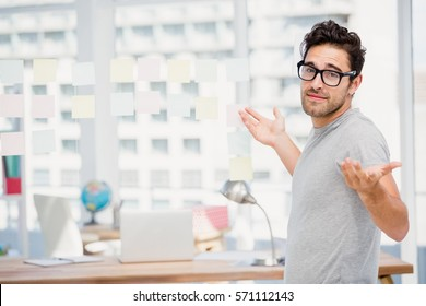 Man shrugging his shoulder in office to say I do not know