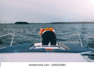 man sick on a yacht at sea. Seasickness. Danger of traveling by boat, swayed.