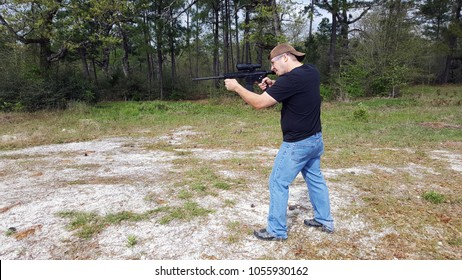 Man sighting in his rifle at a local rifle range, getting ready for the upcoming hunting season