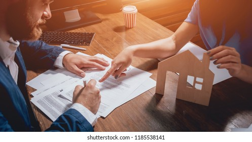 Man sign a home insurance policy on home loans. Estate agent with customer before contract signature. Real Estate concept. Insurance agency concept