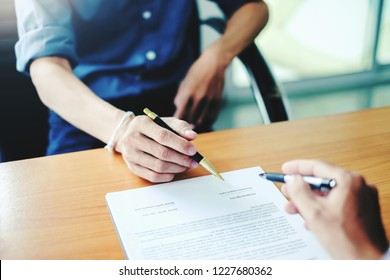 Man signing a contract. Signing an agreement in a document
